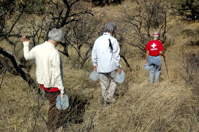 The Samaritans hike into the desert to provide humanitarian assistance.